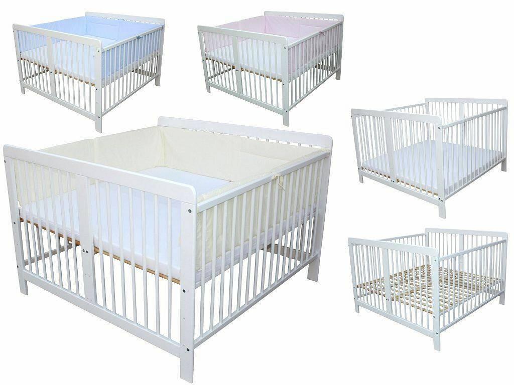 Как выбрать кроватку для новорожденных двойняшек?