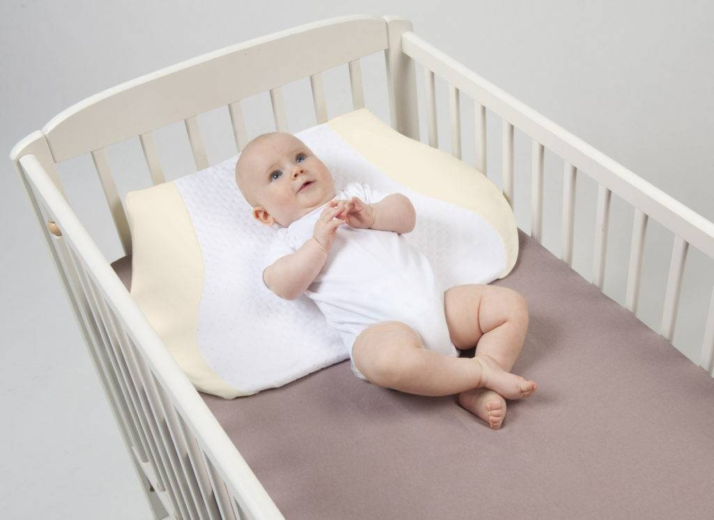 Ортопедическая подушка для грудничка: для чего нужна малышу